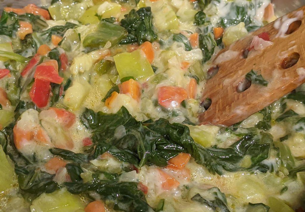 Pochado de verduras con bechamel revuelto